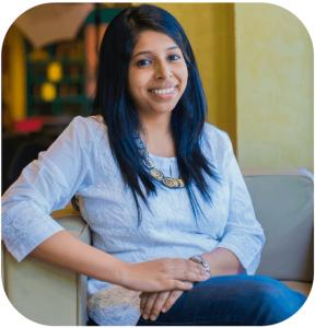 Jyotsna Ramachandran profile picture smiling seated