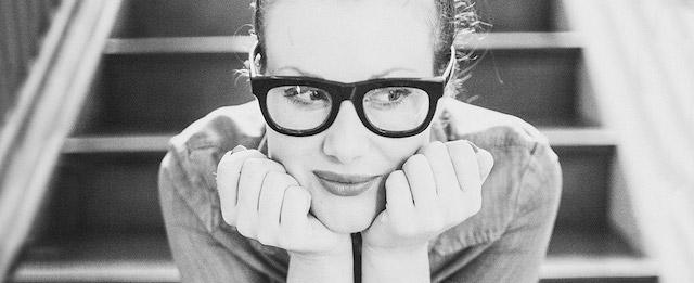 Stocksy United Brianna Wettlaufer wearing glasses sat on stairs